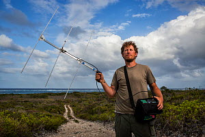 Portrait of scientist Nathan Cooper with telemetry device. Cat Island, Bahamas.  -  Karine Aigner