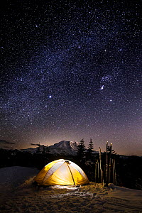 Winter campsite with light in tent at night, Suntop Mountain in the Baker-Snoqualmie National Forest, Washington, USA, March 2018.  -  Kirkendall-Spring