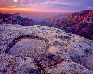 Saddle Mountain overlook (Saddle Mountain at left) at dawn with water filled  rim-rock in the foreground. Grand Canyon National Park, Arizona, USA.  -  Jack Dykinga