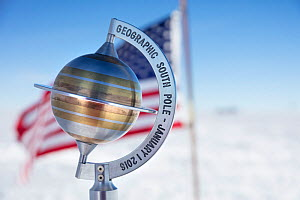 Marker to show geographical South Pole 90 degrees South with USA flag, near Scott-Amundsen base, Antarctica.December 2016 - Sue Flood