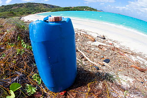 Discarded fuel container on a beach in tourist destination. Lizard Island, Great Barrier Reef, Queensland, Australia. July 2012.  -  Tony Wu