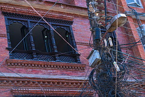 Cables and telegraph pole with building in background, Kathmandu City, Kathmandu Valley, Nepal. February 2018. - Juan  Carlos Munoz