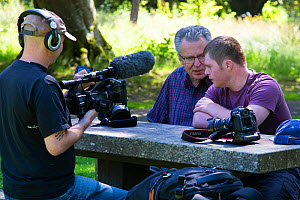 Photographers Oliver Hellowell and Ken Jenkins (Tennessee based photographer) being interviewed on film for the BBC programme The One Show. Balloch Castle, Loch Lomond, Scotland, UK. July 2018  -  Oliver Hellowell