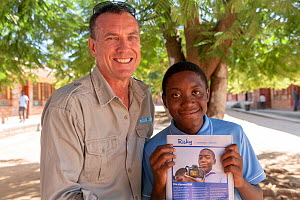 Wild Shots Outreach Director Mike Kendrick with student Ricky Tibane holding GEOlino magazine which features a photo he took during a Wild Shots Outreach workshop. South Africa. April 2018.  -  Wild Shots Outreach