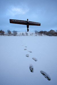 Footsteps in the snow leading up to The Angel of the North, Gateshead, Tyne and Wear, England. November 2010 - Guy Edwardes