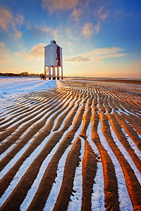 Sand patterns with ice between ripples of the sand, front of Burnham-on-Sea Lighthouse in winter, Somerset, England, UK, January.. January 2010  -  Guy Edwardes