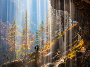 View of hikers from behind the Pericnik Waterfall, Slovenia, October 2018.  -  Guy Edwardes