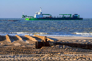 DEME trailing suction hopper dredger Uilenspiegel at sea, used for sand replenishment / beach nourishment to make wider beaches to reduce storm damage, Belgium, 2018  -  Philippe Clement