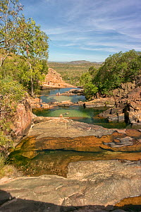 People swimming in freshwater pools on Waterfall Creek, at the top of Gunlom Falls. Mary River, Kakadu National Park, Northern Territory, Australia. March 2014. - Steven David Miller