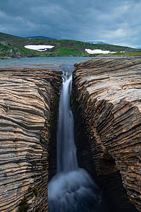 Marble formations with waterfall on a lake shore. Lahko National Park, Fjell, Norway, July.  -  Erlend Haarberg