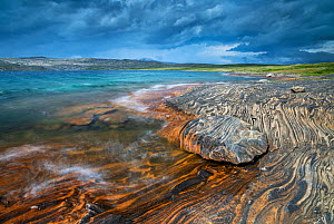 Marble formations on a lake shore. Lahko National Park, Fjell, Norway, July.  -  Erlend Haarberg