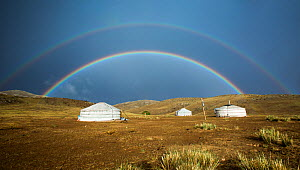 Double rainbow over traditional gers / yurts, steppe grassland, Altanbulag, Mongolia, June 2017. - Paul Williams