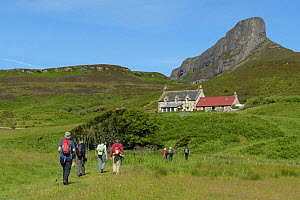 Walkers on the isle of Eigg, in the Small Isles, Scotland. July 2017. - Chris Gomersall