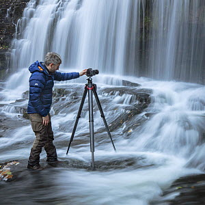 Photographer Guy Edwardes working in river in the Brecon Beacons, Wales, UK, October 2018. - Guy Edwardes