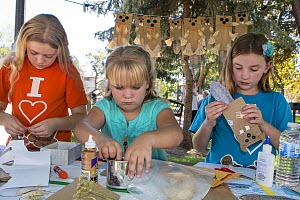 Children, supporters of Martinez Beavers, making beaver crafts. Martinez, California. September 2015. Model released.  -  Suzi Eszterhas
