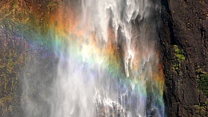 Close-up shot of Wallaman Falls, with rainbow, Wet Tropics World Heritage Area, Ingham, Queensland, Australia. 2017.  -  Jurgen Freund