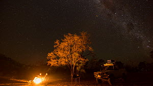 Timelapse of photographers Stella and Jurgen Freund camping, with campfire, Chillagoe, North Queensland, Australia, 2015. - Jurgen Freund