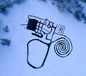 Skating area labyrinth surrounded by snow, aerial view. Akershus, Norway. December 2017. - Pal Hermansen