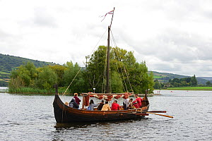 Replica Viking longboat on Llangorse Lake and the Crannog, a 9th Century man-made island, Brecon Beacons National Park, Breconshire, Wales, September 2018. - Will Watson