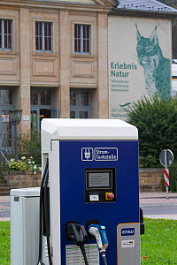 Electric car charging point in front of Saxon Switzerland National Park information centre. Eurasian lynx (Lynx lynx) branding on wall. Bad Schandau, Saxony, Germany.  -  SCOTLAND: The Big Picture