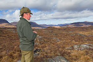 Deer stalker looking out over moorland landscape. Reraig Forest, Lochcarron, Highlands, Scotland, UK. - SCOTLAND: The Big Picture