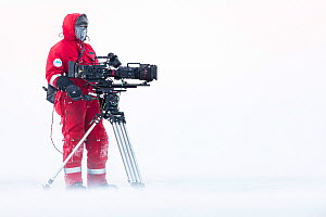 Cameraman Lindsay McCrae with camera on location for BBC Dynasties Penguin programme. Atka Bay, Antarctica. July 2017. - Stefan Christmann