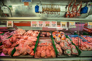 Butcher counter with meat for sale in supermarket, north London, England, UK. - Matthew Maran