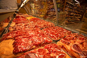 Meat for sale at butchers counter in supermarket,, North London, England, UK.  -  Matthew Maran