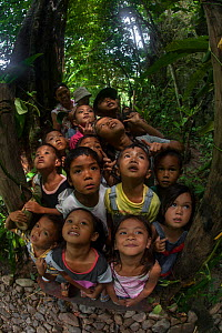 Young children from Barangay Tagabinet having a nature walk around Ugong Rock, Palawan, the Philippines. - Duncan Murrell