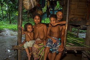 Batak family in their house in their village in the forest, Sitio Kalakwasan, Cleopatra's Needle Critical Habitat, Palawan, the Philippines. October 2016. - Duncan Murrell