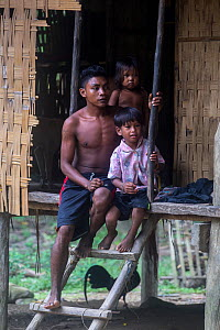 Batak people outside house, South Palawan, the Philippines. September 2017  -  Duncan Murrell