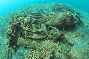Discarded ghost nets from fishing boats on the sea bed, choking coral reefs, Sulawesi, Indonesia. November 2018.  -  Juergen Freund