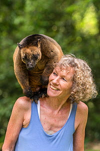 Wildlife carer Margit Cianelli with Lumholtz tree kangaroo (Dendrolagus lumholtzi) 'Geoffrey' which she raised from a joey, Atherton Tablelands, Queensland, Australia. Model released.  -  Jurgen Freund