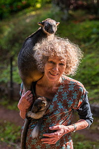 Margit Cianelli wildlife carer with young Lumholtz kangaroos (Dendrolagus lumholtzi), one with a radio collar. The tree kangaroo has a radio collar to allow her to explore her forest surroundings read... - Jurgen Freund