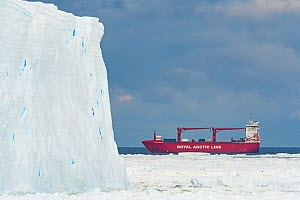 Mary Arctica cargo ship in Atka Bay with ice shelf and sea ice in foreground. Atka Bay, Antarctica. February 2017. - Stefan Christmann