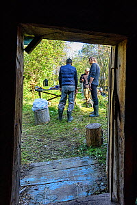 View through door of people talking, whilst on diving expedition. Upper reaches of the Lena River Baikalo-Lensky Reserve, Siberia, Russia. August 2018.  -  Olga Kamenskaya
