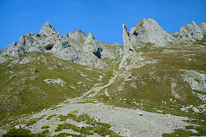 Pica de Balbin and Pena Fresnidiello limestone peaks either side of the Canal de Lechangos scree-filled gulley above the Vega Fresnidiello, near Sotres, Picos de Europa, Asturias, Spain, August 2016.  -  Nick Upton