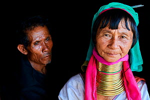 Portrait of a Kayan Lahwi woman with her husband. The Long Neck Kayan (also called Padaung in Burmese) are a sub-group of the Karen ethnic people from Burma. They wear spiral coils around their neck a...  -  Eric Baccega
