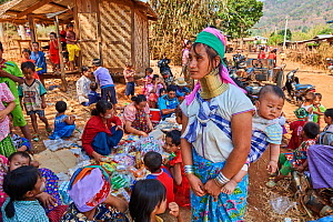 Kayan Lahwi women at the Kay Htein Bo village celebration. The Long Neck Kayan (also called Padaung in Burmese) are a sub-group of the Karen ethnic people from Burma. They wear spiral coils around the...  -  Eric Baccega