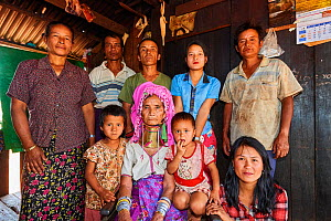 Multi-generational Kayan Lahwi family portrait. The grand mother is wearing the traditional brass neck coils and clothing, which the youger women have decided not to put on any more. The Long Neck Kay...  -  Eric Baccega