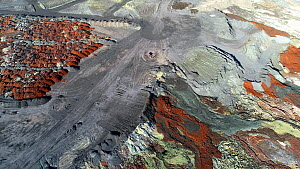 Aerial shot of mining waste and other toxic by-products collected in dry stacks and a big pond, in a large copper mining  and hydrometallurgical process plant complex near Gerena, Seville, Spain, Augu... - Milan Radisics