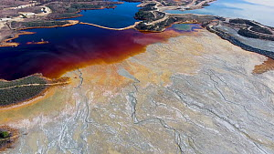Aerial shot of an artificial lake polluted by extractive pyrite mining by Rio Tinto, the orange color comes from sulfite and the blue is a reflection of the sky, Minas de Riotinto, Andalusia, Spain, J... - Milan Radisics