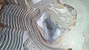 Aerial shot of an open mine pit and process plant in a copper mining and hydrometallurgical process plant complex, near Gerena, Seville, Spain, August 2018. The site occupies 946 hectares, including b... - Milan Radisics