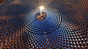 Aerial shot of the Gemasolar Thermosolar Plant owned by Torresol Energy, it uses molten salt as its heat transfer fluid and energy storage medium to produce energy for up to 24 hours a day, Seville, S...  -  Milan Radisics