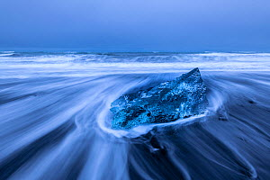 RF - Sculptured glacial ice on the black or 'diamond' beach at Jokulsarlon Glacier Lagoon, Iceland. December 2017. (This image may be licensed either as rights managed or royalty free.) - Ross Hoddinott