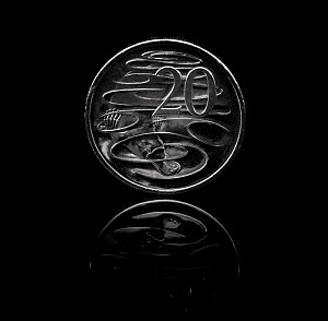 Platypus (Ornithorhynchus anatinus) on Australian 20 cent coin, black background. Coin designed and sculpted by Stuart Devlin.  -  Doug Gimesy
