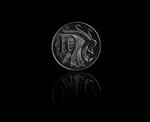 Superb lyrebird (Menura novaehollandiae) male on Australian 10 cent coin, on black background. Designed and sculpted by Stuart Devlin.  -  Doug Gimesy
