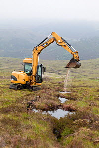 Digger creating pools on upland peat moor to retain rainwater and create wetland habitat more suitable for sphagnum moss, Alladale Estate, Sutherland, Scotland, UK., July 2012. - SCOTLAND: The Big Picture
