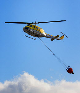 Fire service helicopter with water dump container. Cape Town, South Africa. 2015. - Tony Heald