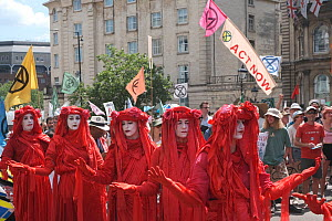 The Red Brigade performance artists on Extinction Rebellion climate change protest march. Bristol, England, UK. 16 July 2019.  -  Ben Gillett